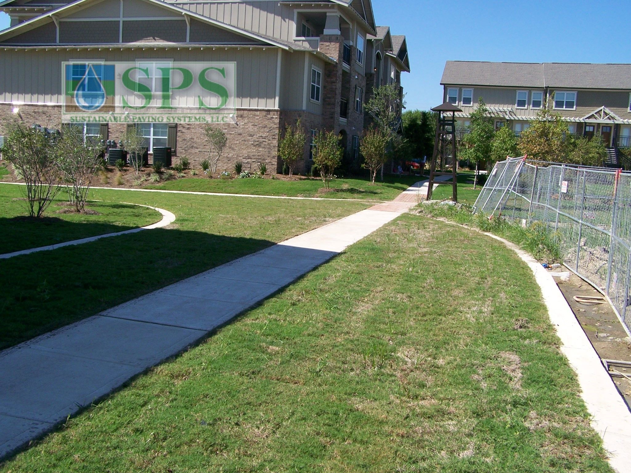 Grasscrete Concealed System At Woodlands At College Station View Of Firelane Early Growth_11