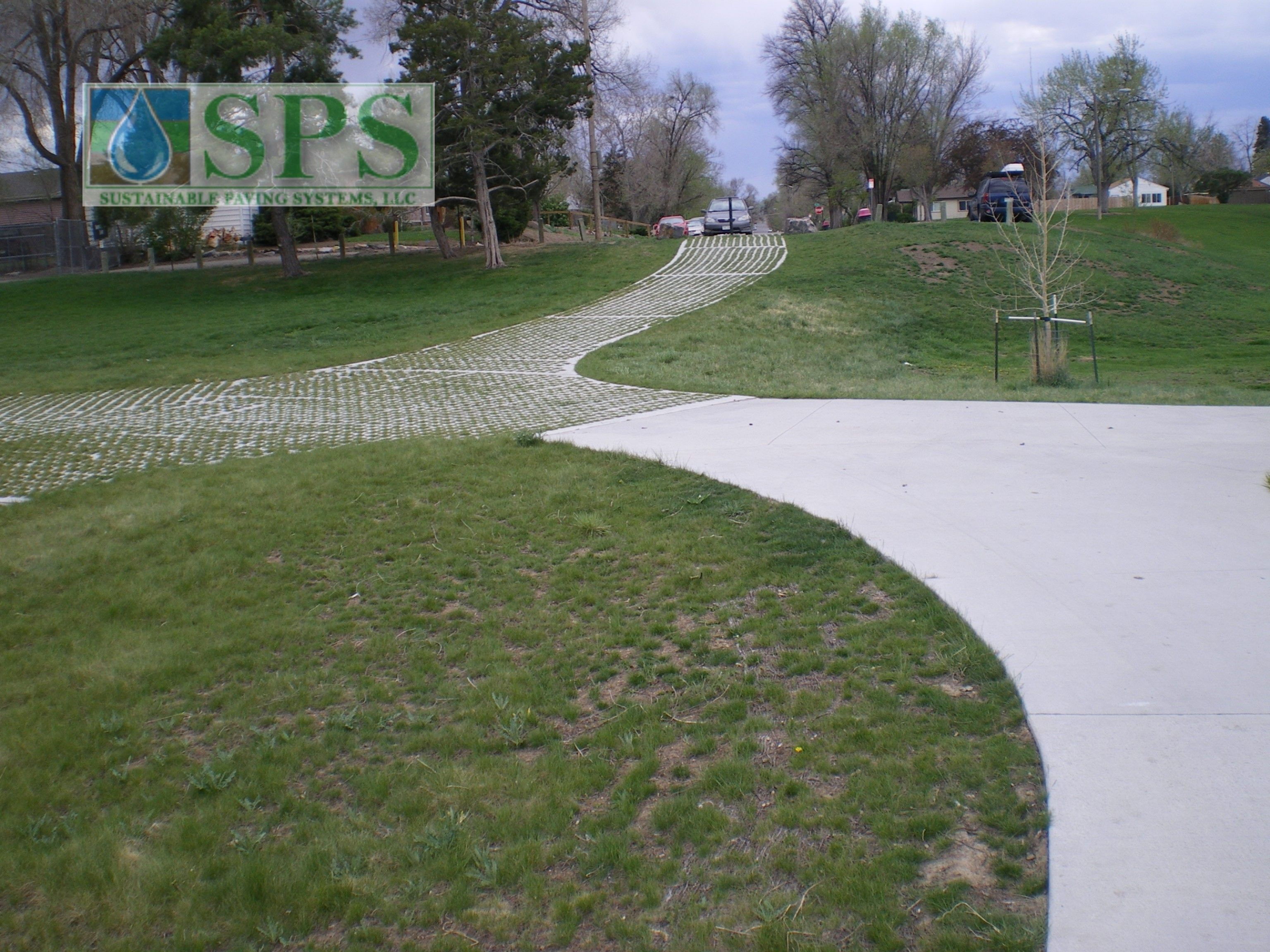 The Grasscrete shown here is a green alternative to typical concrete surfaces, providing a variety of landscape solutions, and alleviating drainage issues while maintaining strong structural integrity.