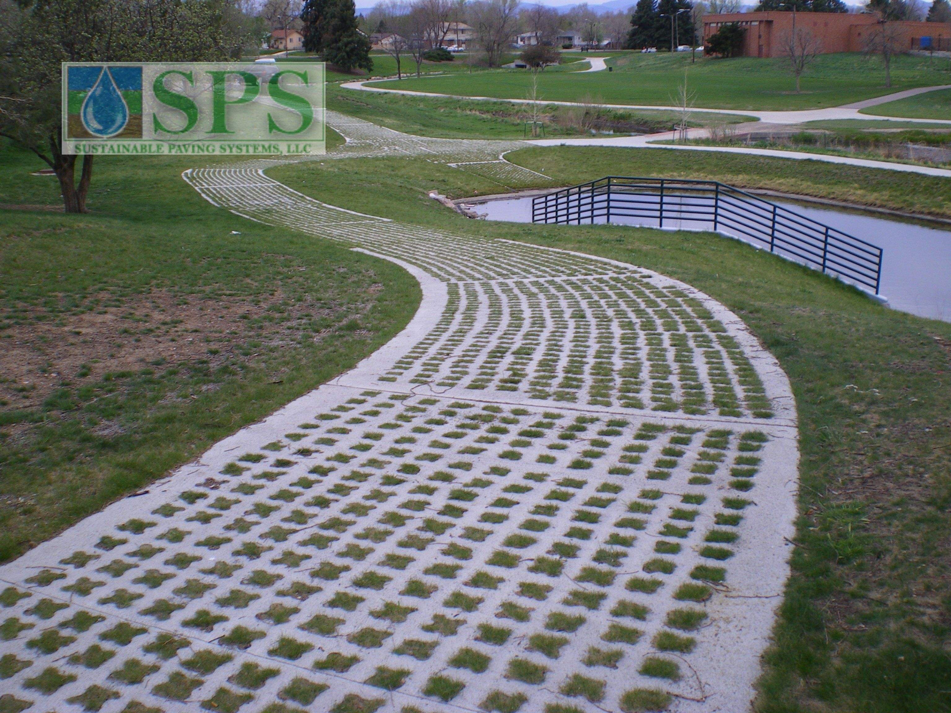Grasscrete was installed here to provide a pervious concrete system that will allow water to pass freely through while maintaining a structural integrity that is suitable to support the weight of required maintenance vehicles.