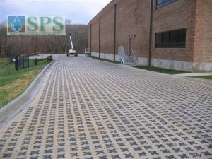Grasscrete Stone Filled System At Plum Way II Commercial Building in Lake Carmel, NY, with a heavy duty truck traffic capacity.