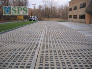 Grasscrete Stone Filled System At Plum Way II Commercial Building in Lake Carmel, NY, with a long view of parking area.