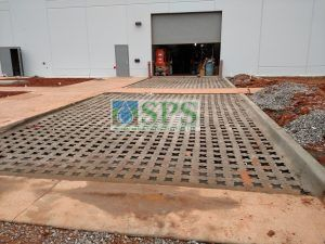 Punched out voids after pour and day of drying for the Grasscrete Fully Concealed Pervious Concrete project at Boeing Company in Oklahoma City near Tinker Air Force Base installed by Bomanite of Oklahoma.