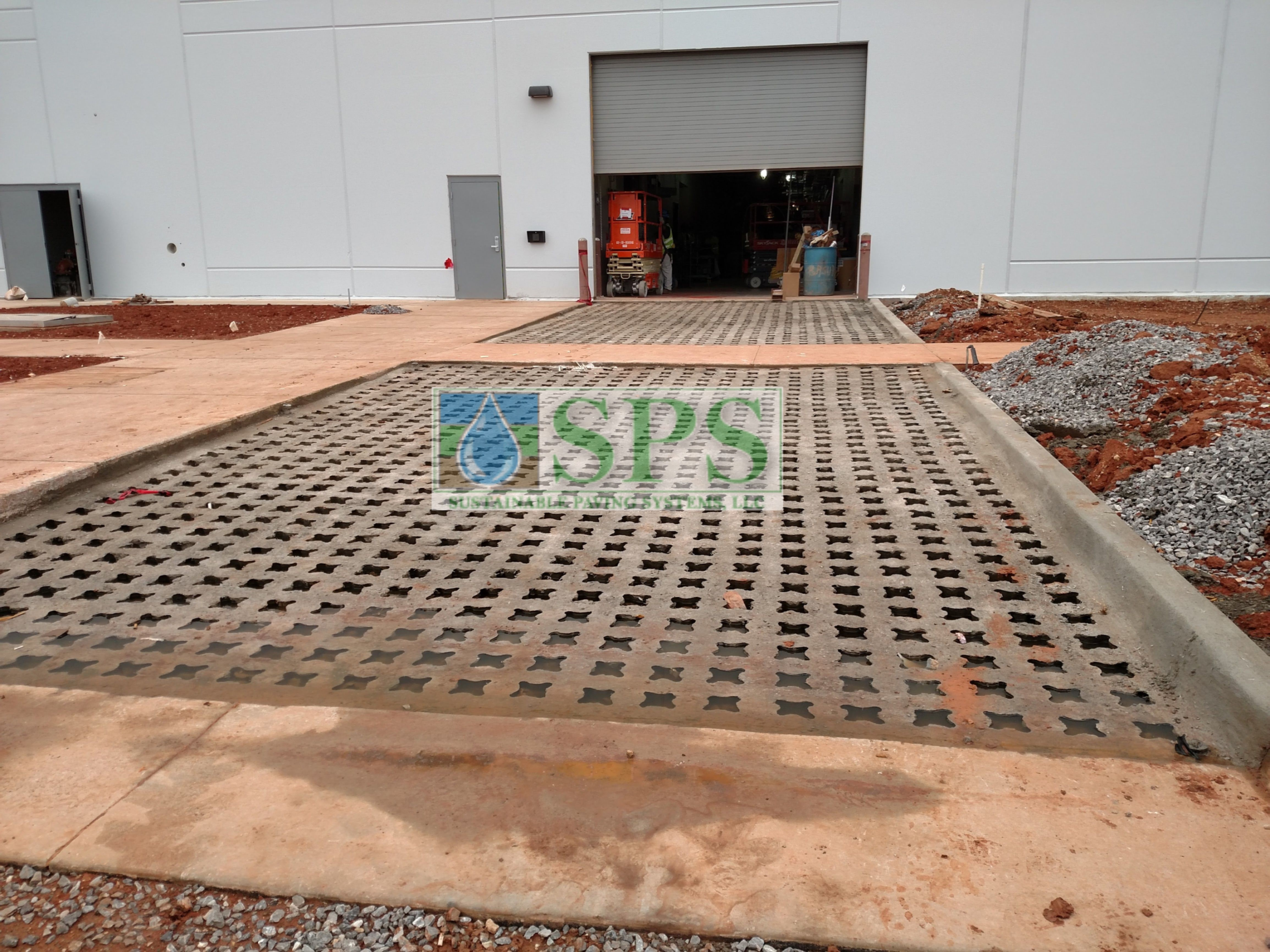 Driveway bay doors after concrete poured and the voids punched for Grasscrete Fully Concealed System at Boeing Company in Oklahoma City, OK, installed by Bomanite of Oklahoma..