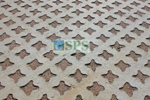 Close up of the punched out and filled voids of the Grasscrete Stone Filled Pervious Concrete parking lot at Sprouts Farmers Market in Denton installed by Texas Bomanite.