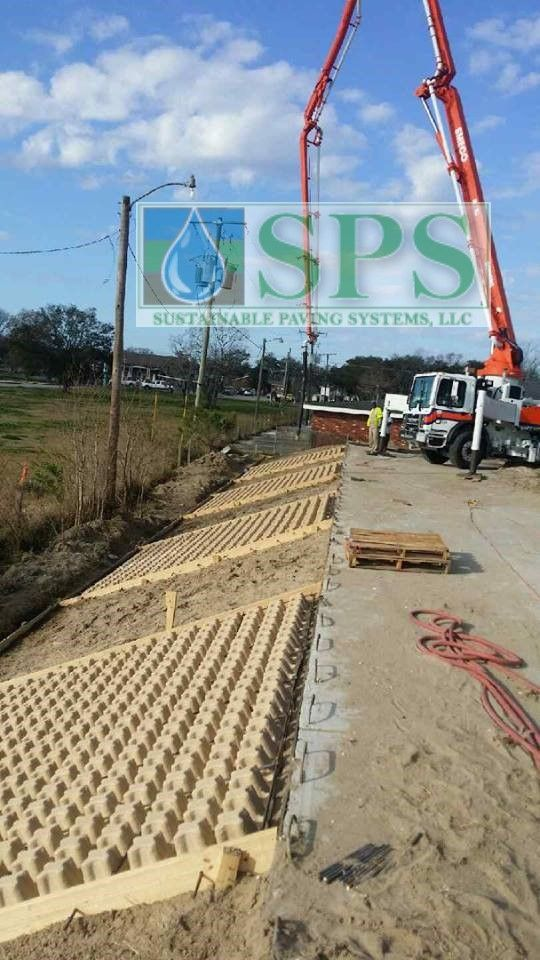 A veiw of the steep slope caused by raising Lafitte Auditorium out of the flood plain and using Grasscrete Concealed System for slope protection.