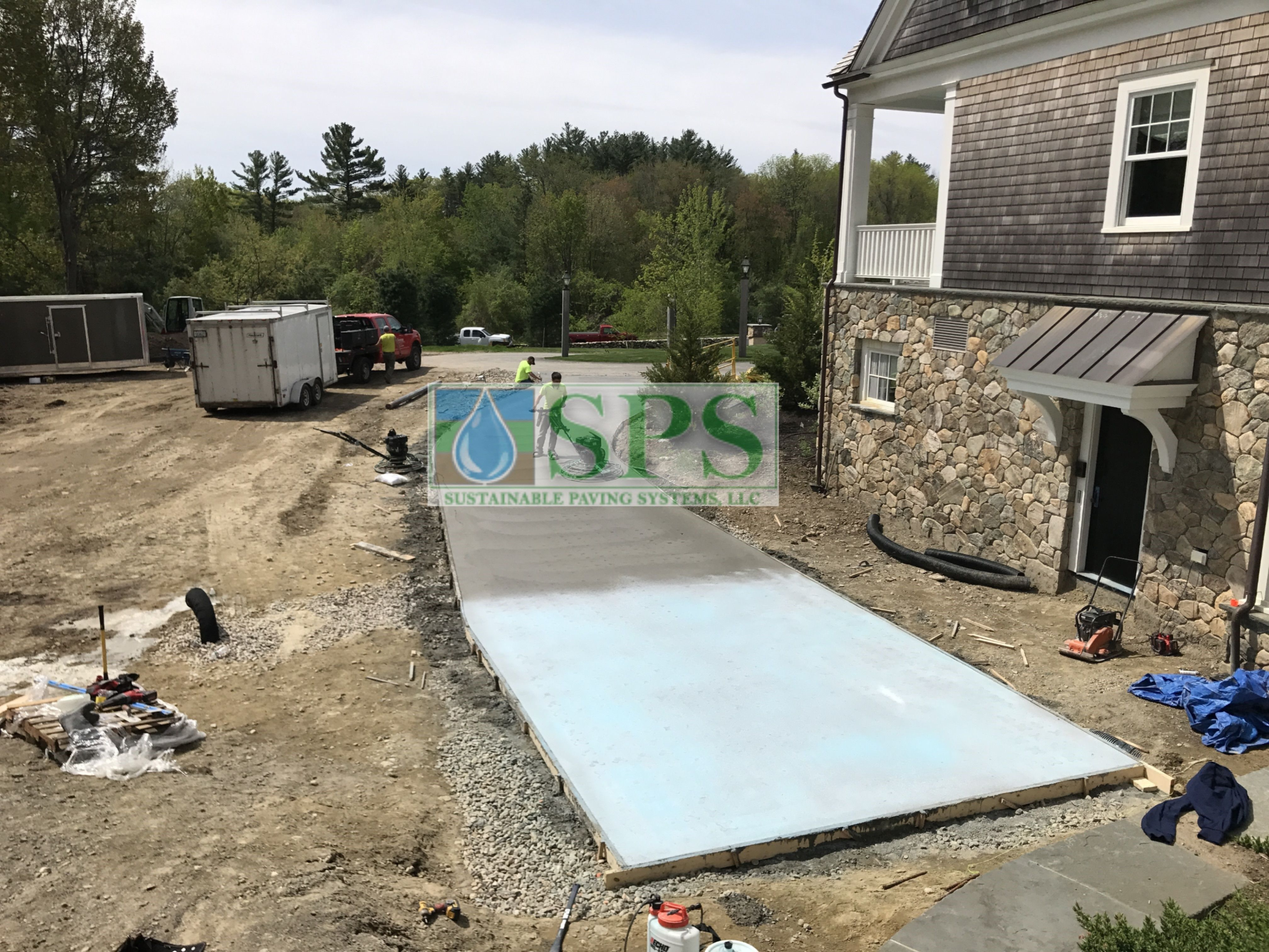 After the pour, Pervious Grascrete concrete is drying and curing before a punch tool is employed to create the voids into which grass will be planted to complete the Partially Concealed Grasscrete System.