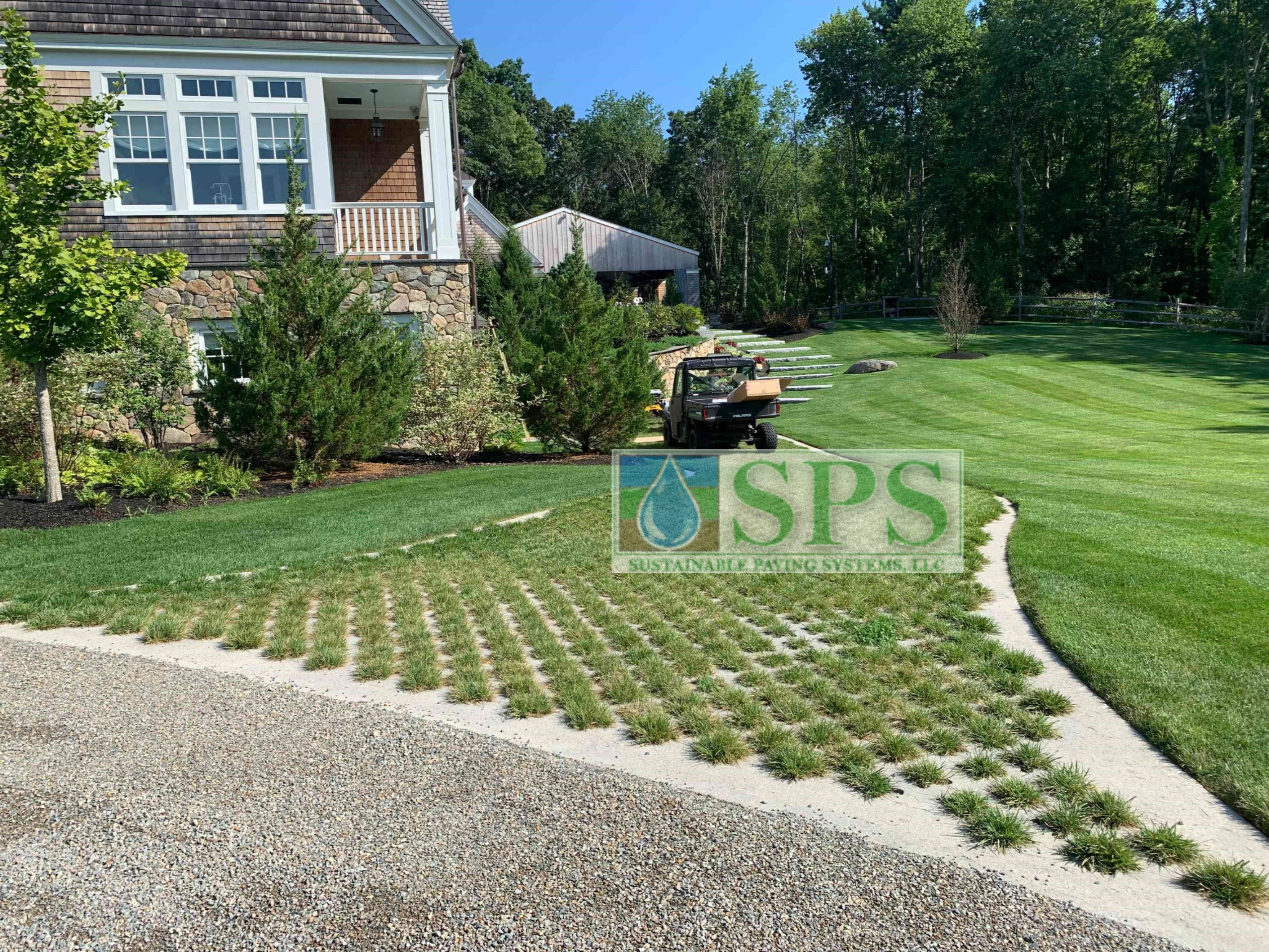 A view of the Partially Concealed Grasscrete Pervious Concrete installation with a delivery vehicle near the house of the Grand Estate in Essex County, MA.