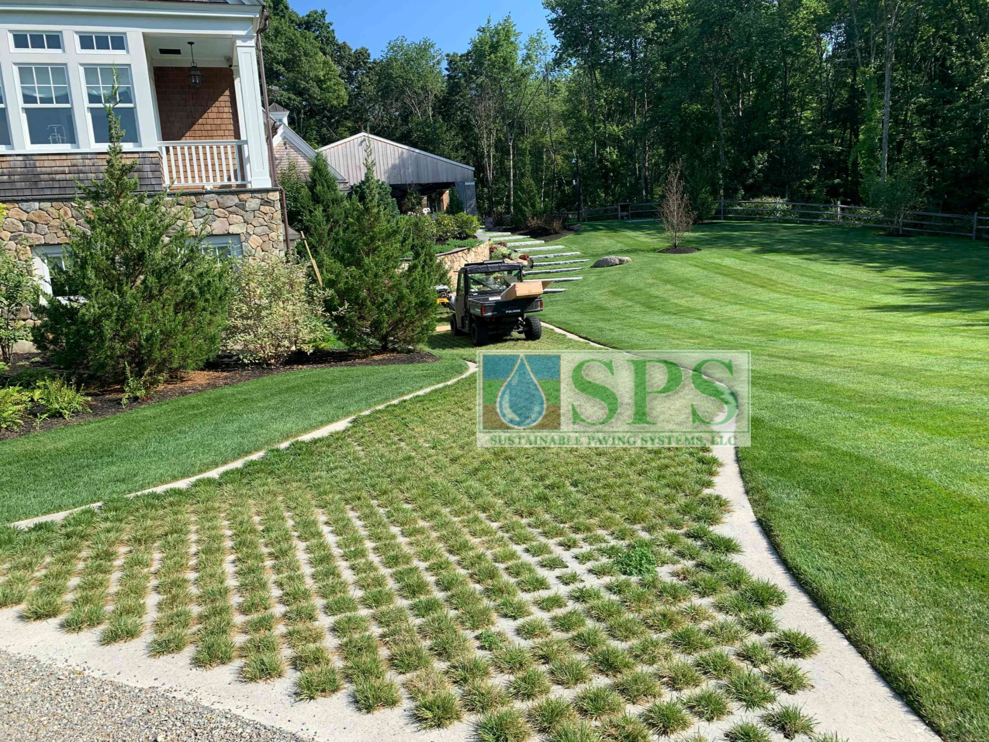 A closer view of the Partially Concealed Grasscrete Pervious Concrete installation with a delivery vehicle near the house of the Grand Estate in Essex County, MA.