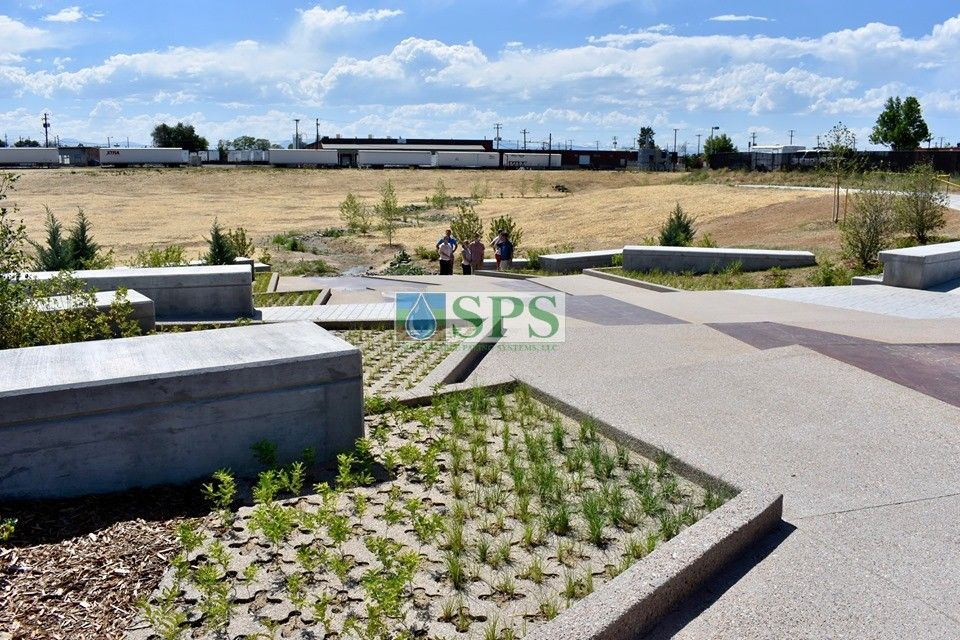 Sustainable Paving Systems Partial Grasscrete System is a pervious monolithic cast-in-place concrete suitable for this gabion tiered drop structure detention pond located in Denver, CO that was planted with varying grasses for greenspace and stormwater management.
