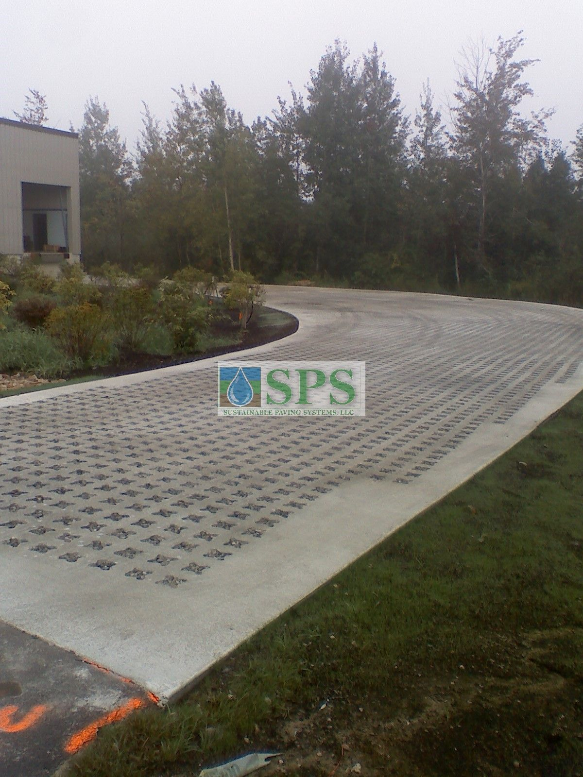 Voids punched and stone filled at Micronics in New Hampshire by Premier Concrete Construction for Grasscrete Success!