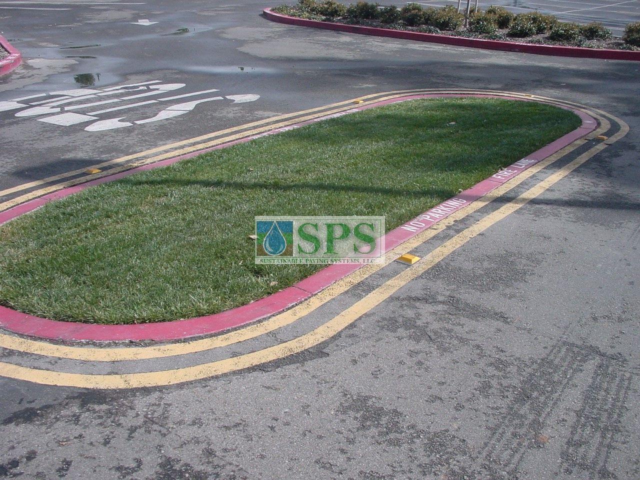 Median of Fully Concealed Grasscrete to provide wider turnaround areas for fire trucks and maintenance vehicles at Woodbury Community Development in Irvine, CA.