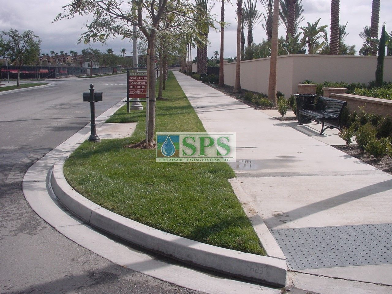 Sidewalk curbing at Woodbury Community Development in Irvine, CA, featuring Concealed Grasscrassete for Water Management and Vehicle Access.