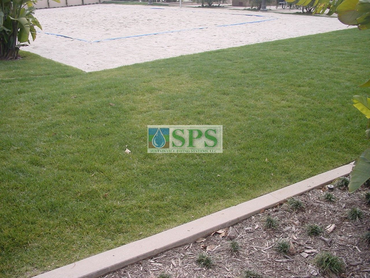 The Volleyball Court has complete Emergency Vehichle Access and Water Management without compromise to the court itself by employing Concealed Grasscrete Systems at Woodbury Community Development in Irvine, CA.