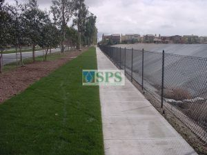 Access points in the landscaping at Woodbury Community Development in Irvine, CA, featuring Concealed Grasscrassete for Water Management and Vehicle Access.