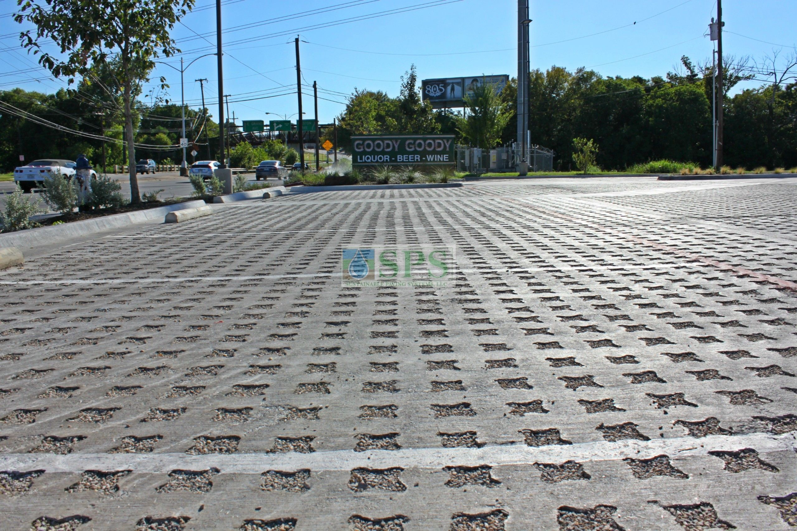 Close up long view of the parking lot of Goody Goody Liquor in Dallas, TX, featuring Grasscrete Stone Filled Systems installed by Texas Bomanite.