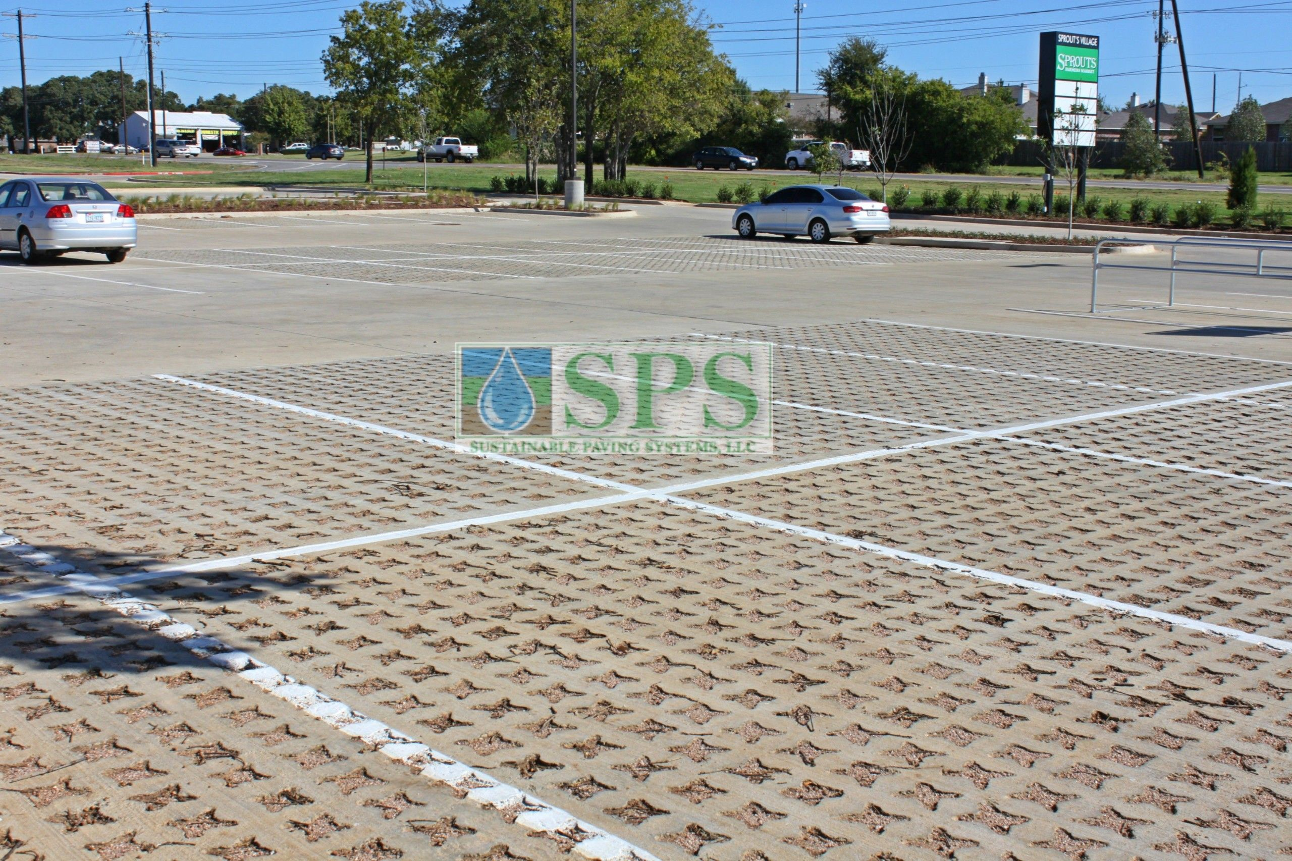 Parking lot view of Grasscrete Stone Filled System at Sprouts Farmers Market in Denton, TX, installed by Texas Bomanite.