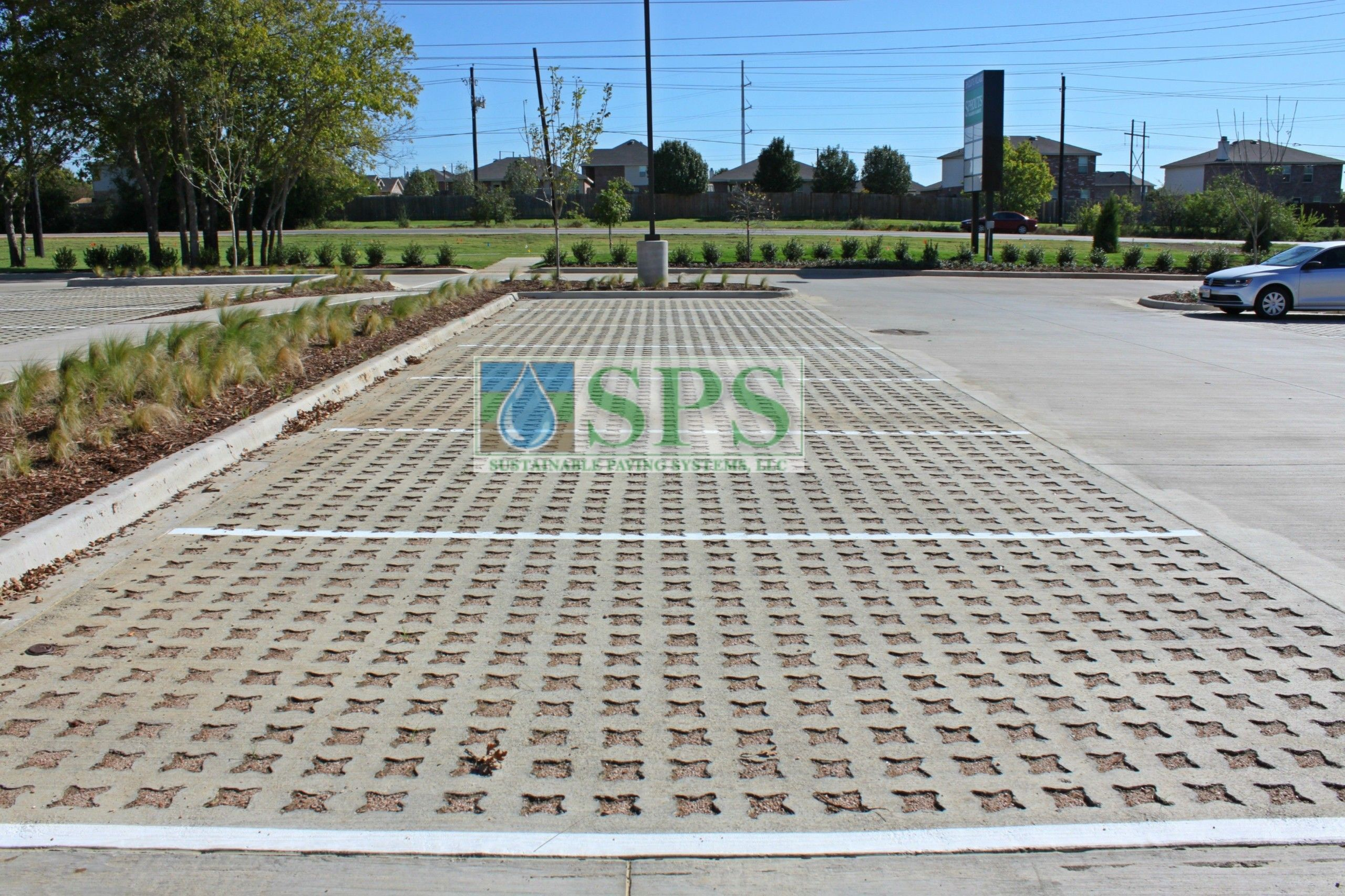 Wider view of parking spaces at Sprouts Farmers Market in Denton, TX, using Grasscrete Stone Filled System installed by Texas Bomanite.