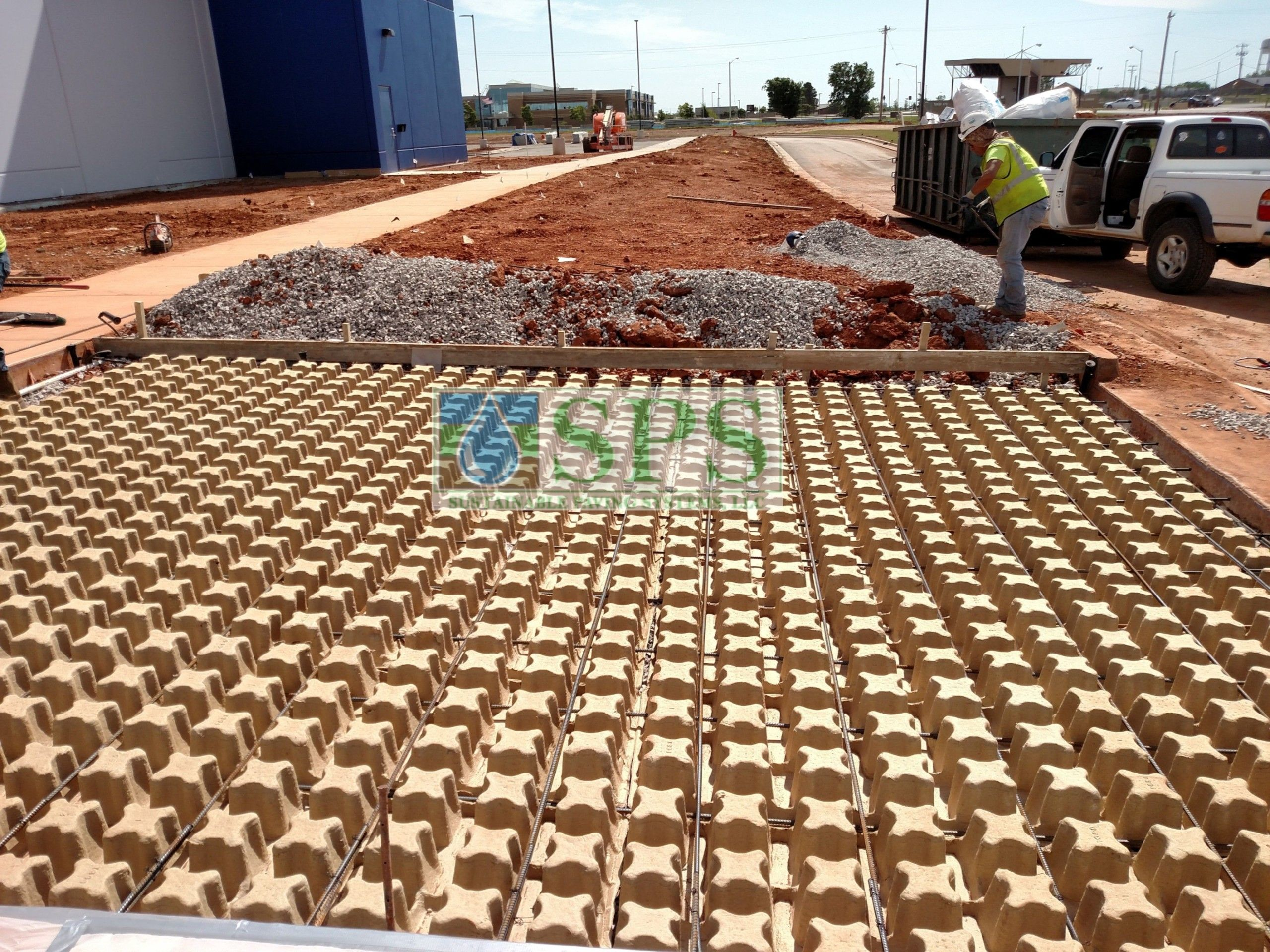 Prepping the area around the molded pulp formers for the Grasscrete Fully Concealed System at Boeing Company in Oklahoma City, OK, installed by Bomanite of Oklahoma..