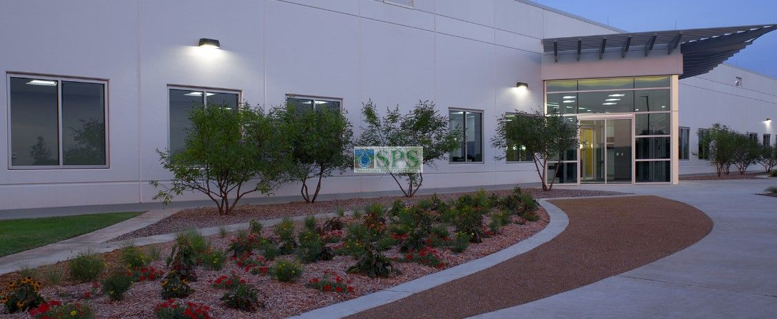 Front entrance at Boeing Company in Oklahoma City, OK, featuring Grasscrete Fully Concealed System, with the ability to withstand heavy loads for vehicle access, installed by Bomanite of Oklahoma..