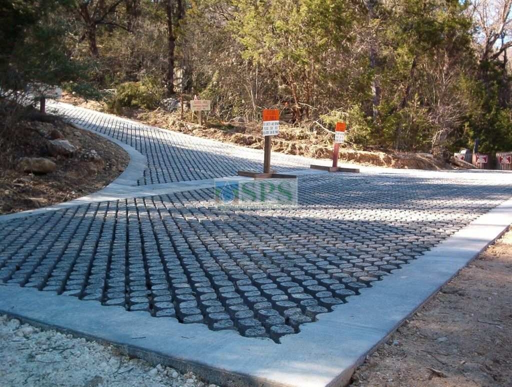 A view of the entrance of the Grasscrete road to Hamilton Park Pool Reserve in Dripping Springs, TX, which is an emergency vehicle access road installed by Texas Bomanite for Travis County providing Sustainable paving solutions to a destination that could be paradise.